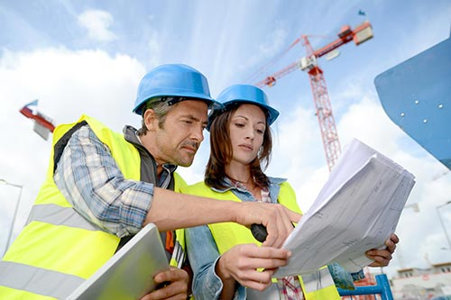 Workers on building site