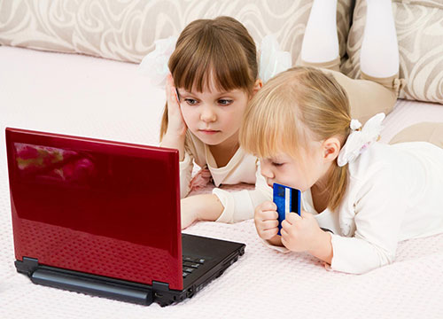 Children looking at a notebook screen